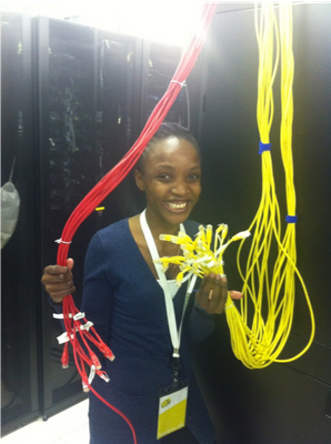 Faith Opiyo holding cables.png
