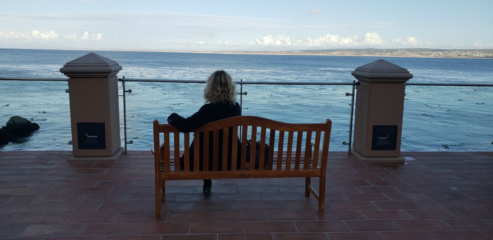 Iryna enjoys a peaceful moment on the Monterey Bay.