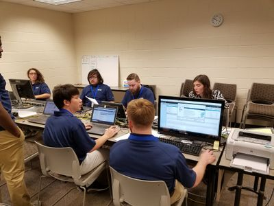 A group of individuals sitting in front of computers at the 2018 South East Regional CCDC.
